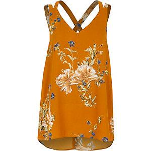 Oranje gebloemd hemdje met dubbele, gekruiste bandjes op de rug