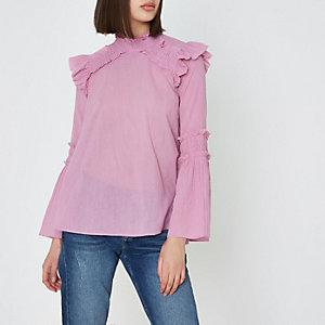Roze hoogsluitende blouse met ruches