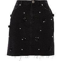 Jupe en jean à fleurs noire ornée de sequins
