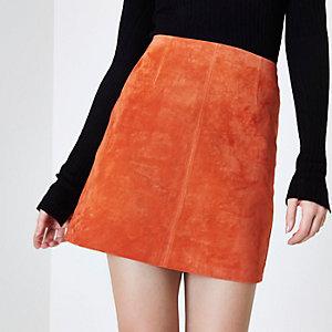 Mini-jupe trapèze en daim rouge