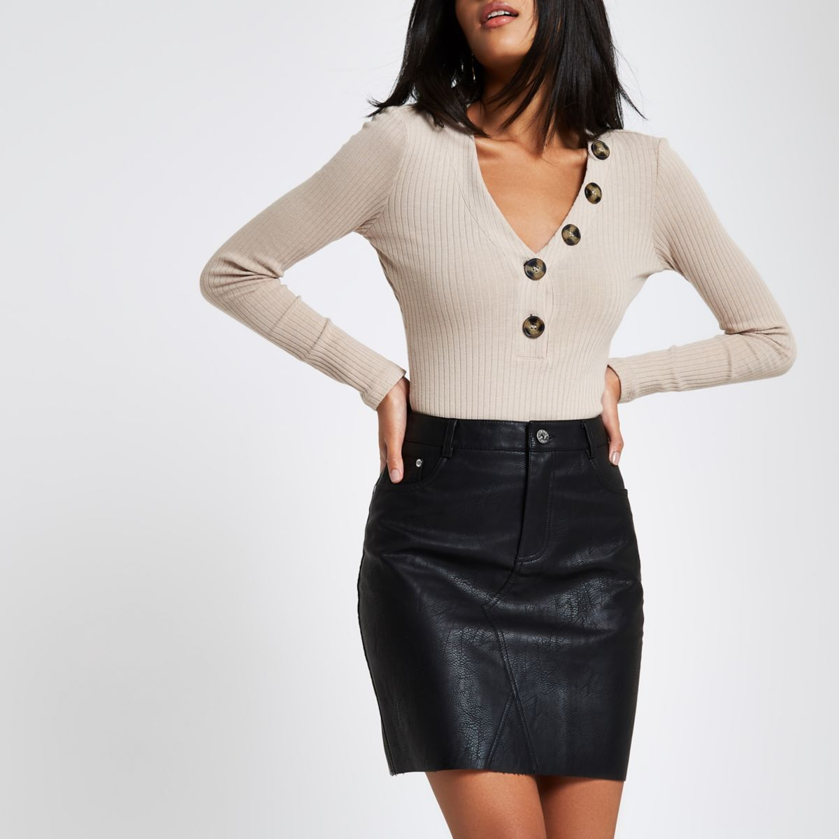 Black faux leather raw edge mini skirt