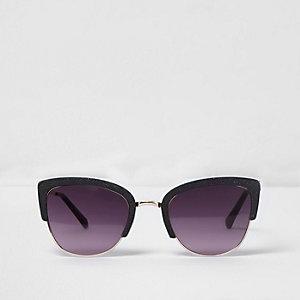 Schwarze, glitzernde Cateye-Sonnenbrille