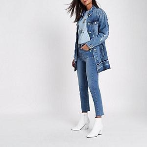 Veste en jean bleu moyen usé à ourlet défait