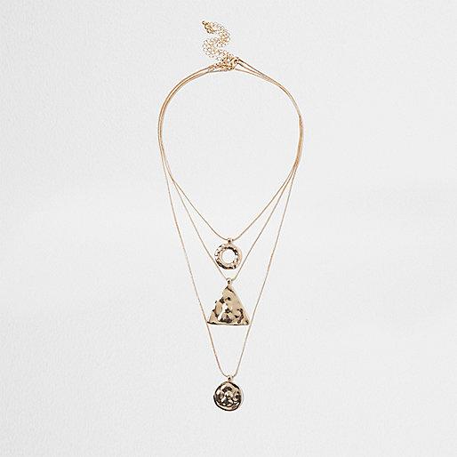 Gold tone multi row shape pendant necklace