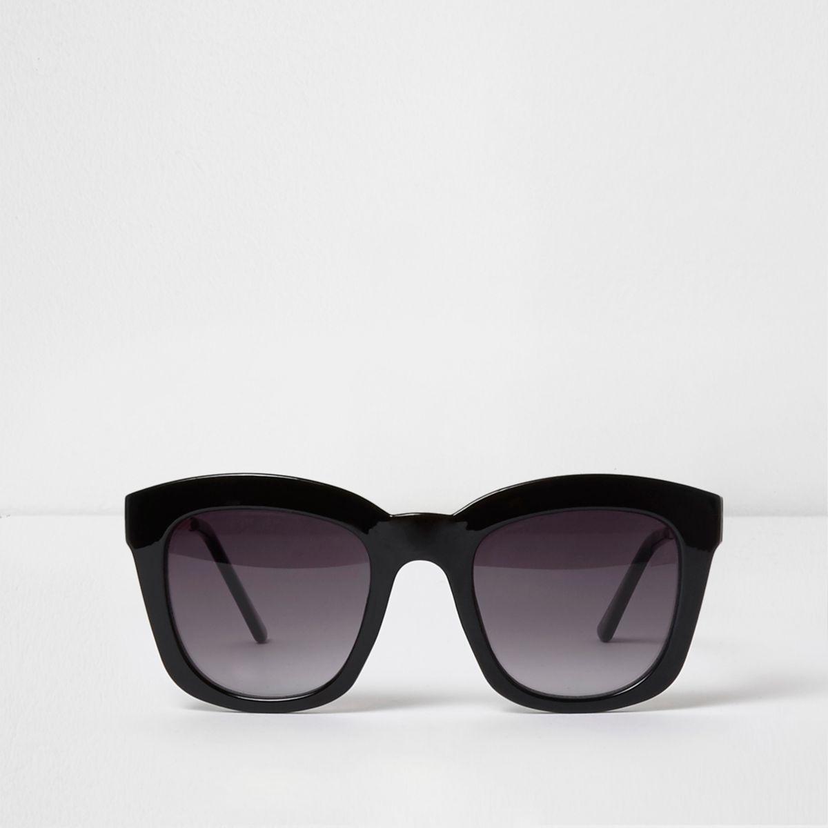 Zwarte oversized zonnebril met betoverend getinte glazen