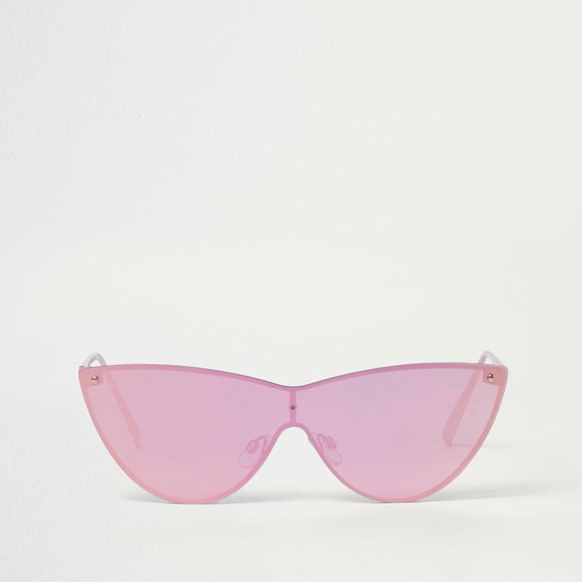 Goudkleurige cat-eye-zonnebril met roze glazen