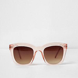 Roze glamour-zonnebril met doorzichtig montuur