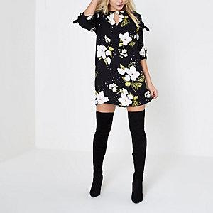 Zwarte tengere jurk met bloemenprint en strik aan de mouwen