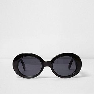 Zwarte zonnebril met ovalen getinte glazen