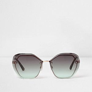 Goudkleurige glamoureuze zonnebril met zeshoekig frame