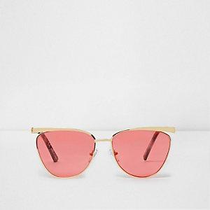 Goldene Cateye-Sonnenbrille mit roten Gläsern