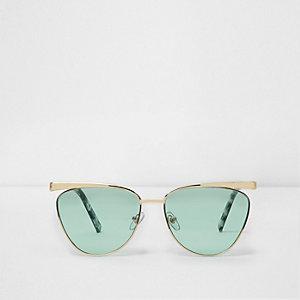 Goudkleurige cat-eye-zonnebril met groene glazen