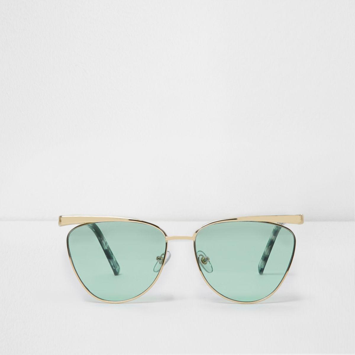 Gold tone cat eye green lens sunglasses