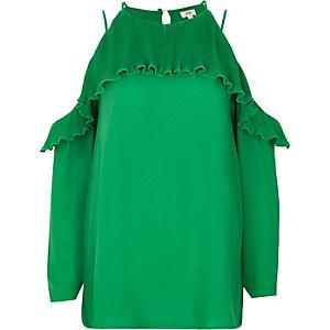 Blouse verte à épaules dénudées et volants plissés