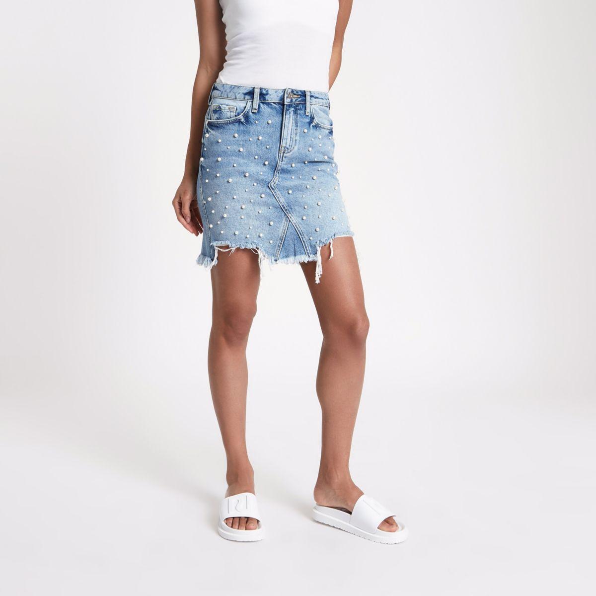 Mid blue faux pearl ripped denim mini skirt