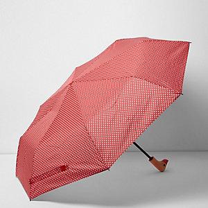 Roter, gepunkteter Regenschirm