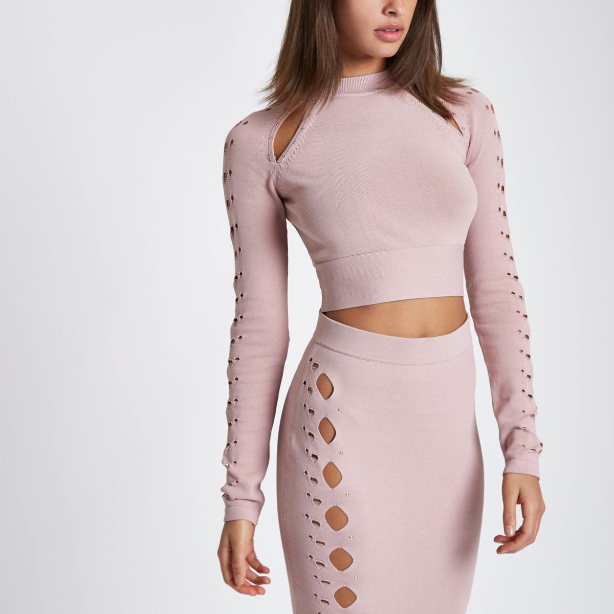 Light pink cut out cropped long sleeve top