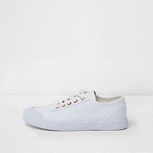 White canvas lace-up trainers