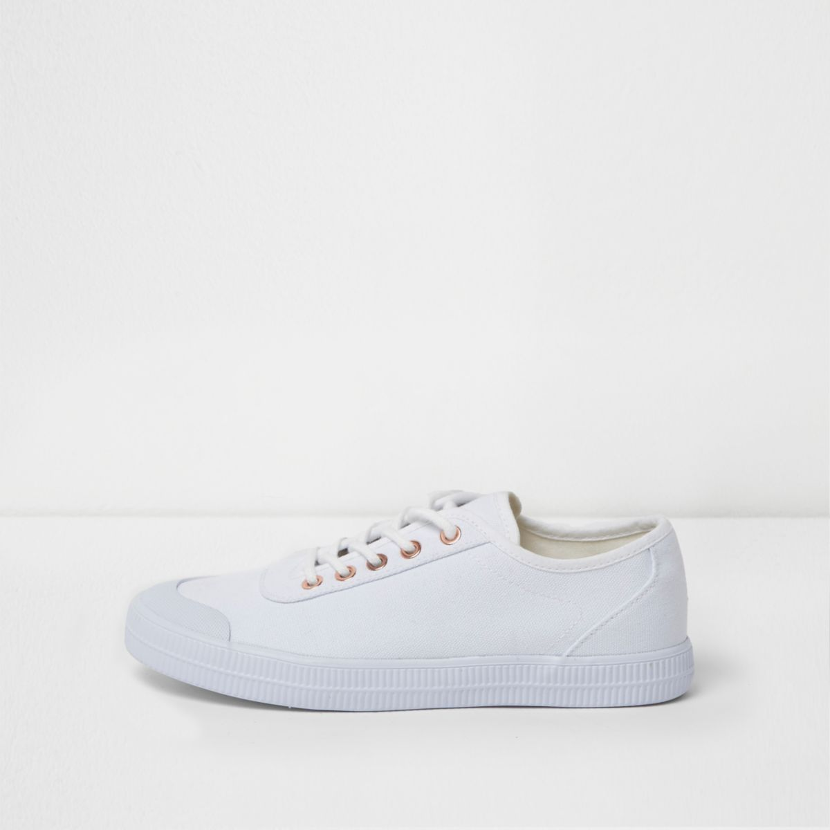 White canvas lace-up sneakers