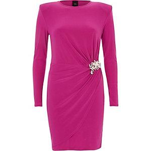 Bright pink pearl brooch wrap bodycon dress