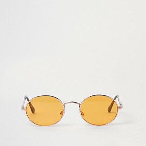 Goldene, ovale Sonnenbrille