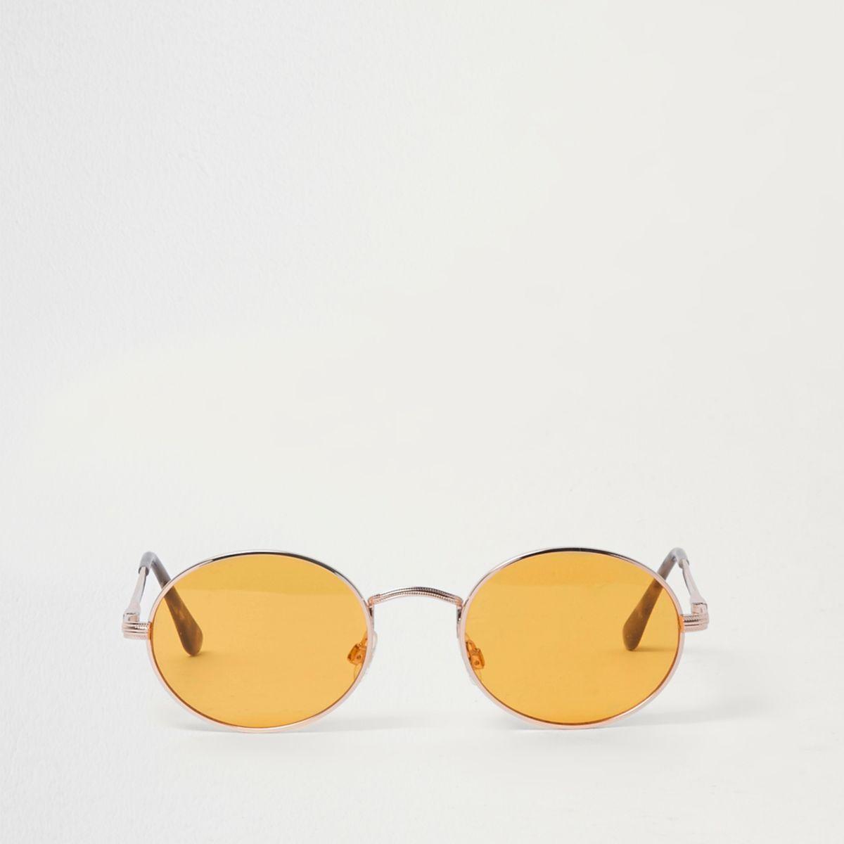 Goudkleurige zonnebril met ovale gele glazen