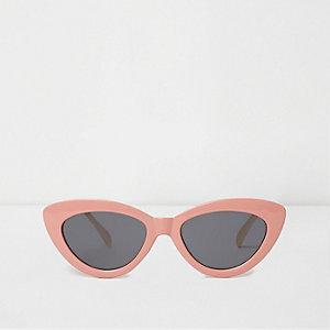 Roze cat-eye-zonnebril met grijze getinte glazen
