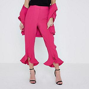 Petite pink asymmetric frill hem trousers