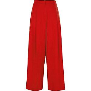 Rode broek met brede pijpen en hoge taille