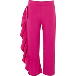 Pantalon court droit rose à volants sur les côtés