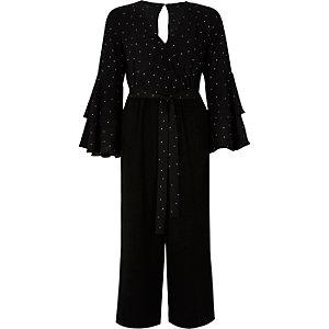 Zwarte jumpsuit met broekrok, lange mouwen en stippen