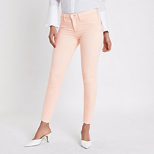 Pink Molly skinny raw hem jeggings