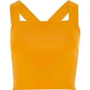 Oranje gebreide crop top met bandjes en D-ring op de rug