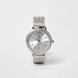 Silberne Armbanduhr mit Diamantverzierung
