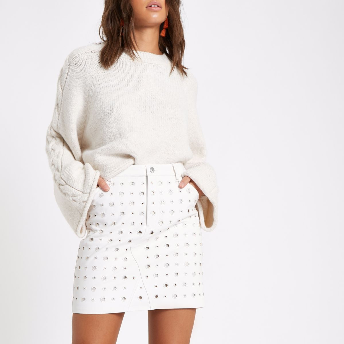 Cream circle faux leather mini skirt