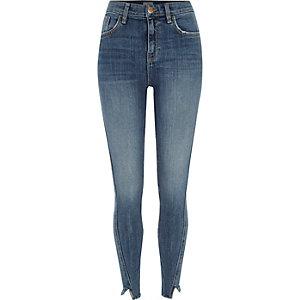 Amelie – Mittelblaue Superskinny Jeans mit ausgefranstem Saum