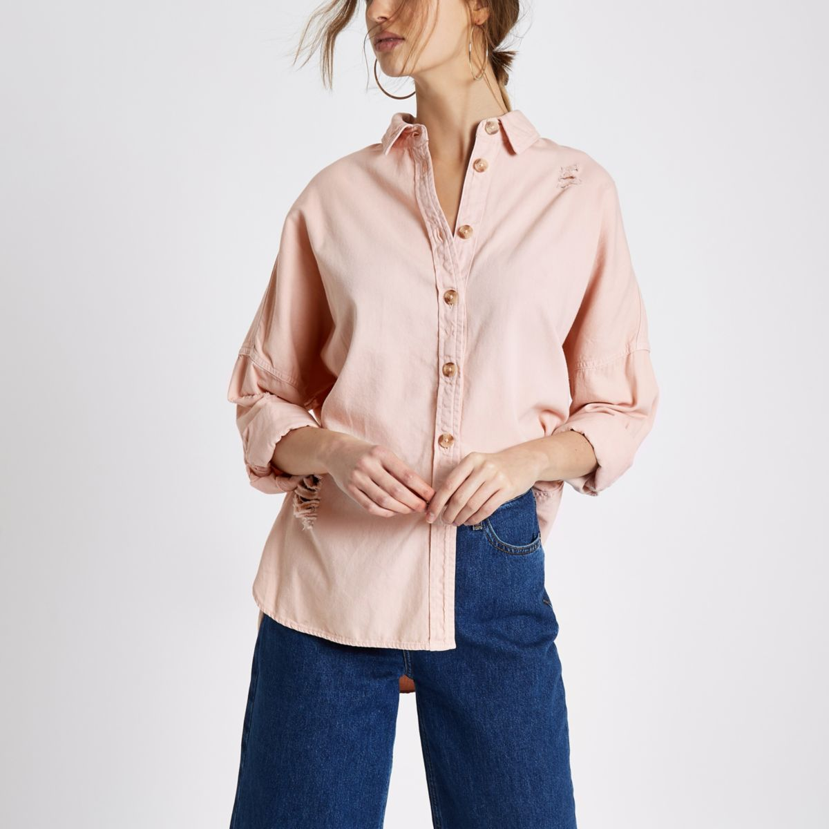 Pink long sleeve ripped denim shirt