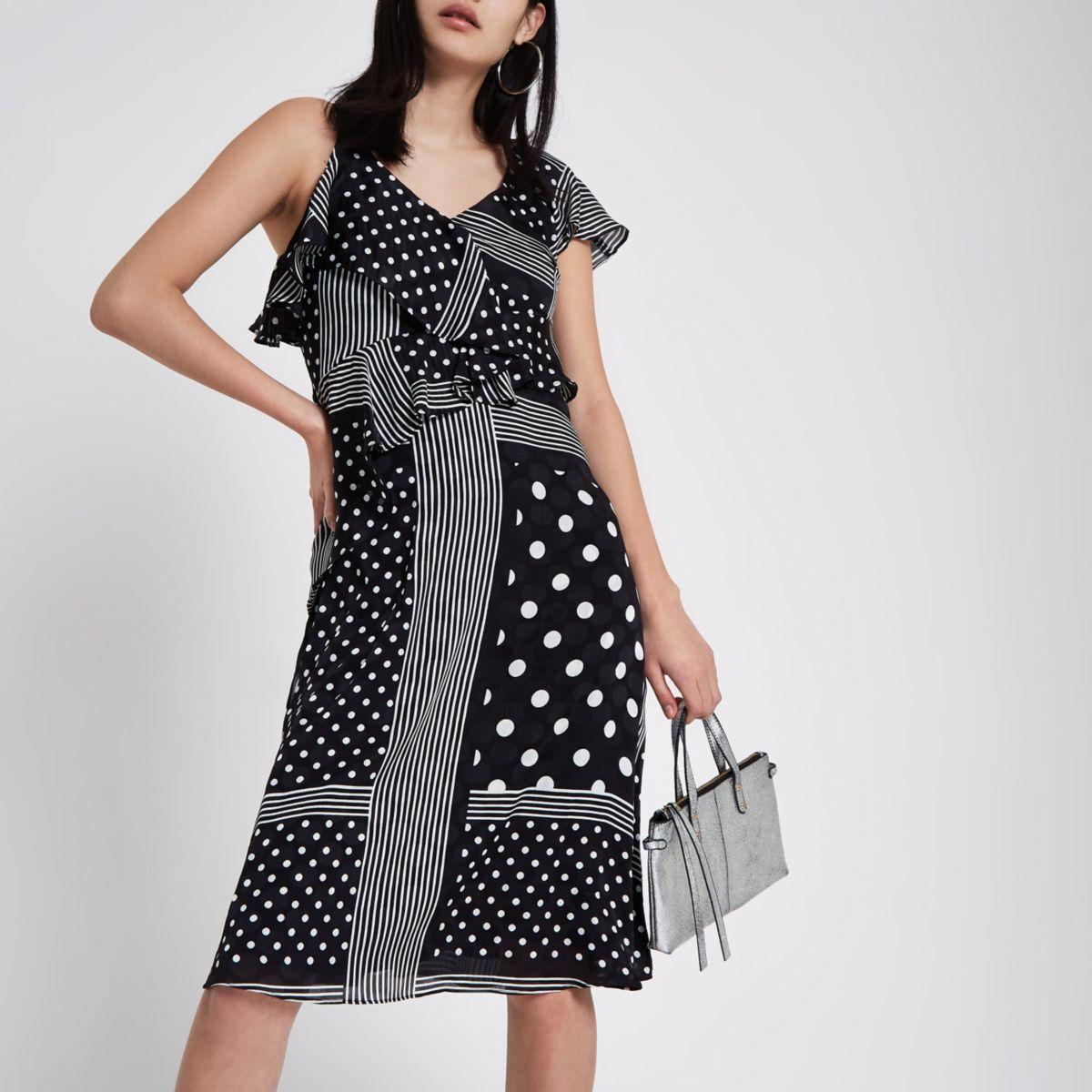 Zwarte midi-jurk met ruches, strikceintuur en stippen