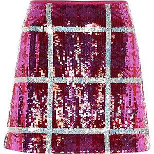 Mini-jupe à carreaux et sequins rose vif