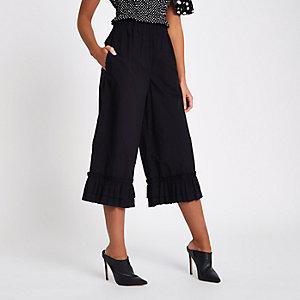 Jupe-culotte large noir à ourlet volanté
