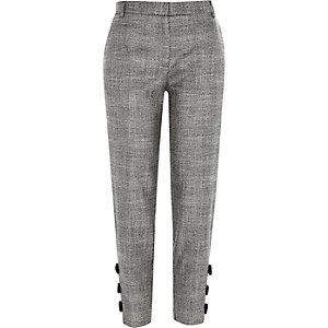 Pantalon cigarette gris à carreaux et nœud sur l'ourlet