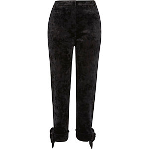 Black crushed velvet bow cigarette trousers