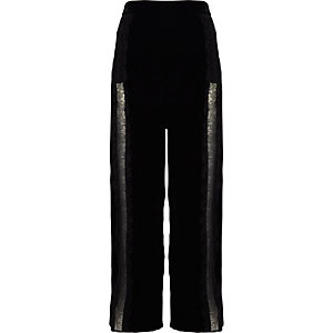 Pantalon large en velours noir à bordure en dentelle