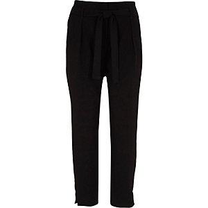 Pantalon fuselé noir bordé de strass