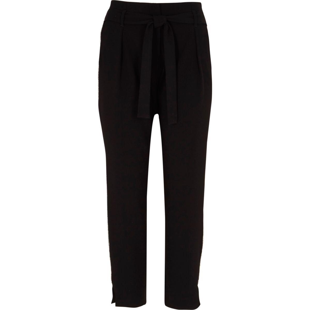 Zwarte smaltoelopende broek met siersteentjes