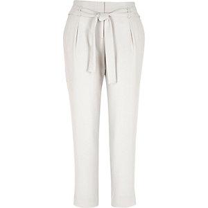 Beige diamante trim tapered trousers