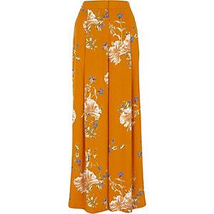 Oranje broek met wijde pijpen en bloemenprint