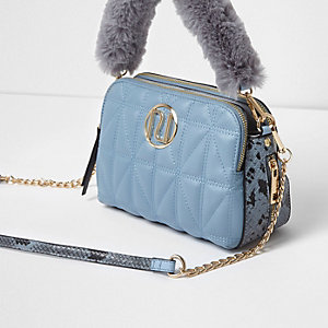 Blue quilted faux fur handle crossbody bag