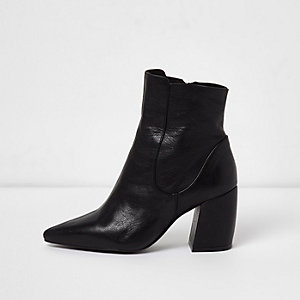 Black leather curved heel pointed ankle boots
