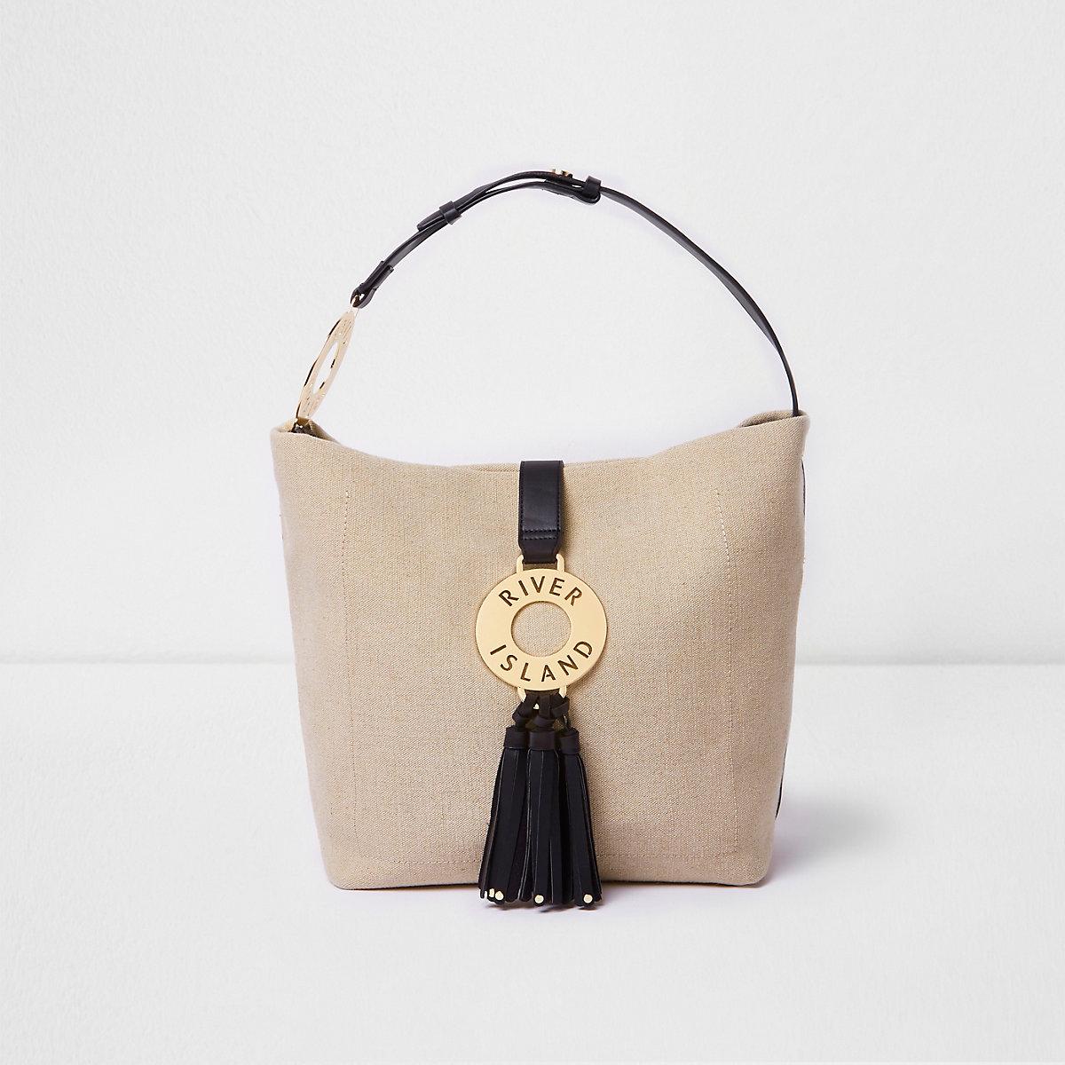 Beige woven ring tassel slouch bag